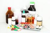 Medical bottles and pills on shelf — Stock Photo