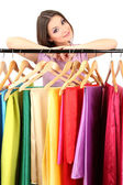 Young girl chooses fabric for future dress isolated on white — Stock Photo