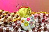 Buttons of different colors, and the two tangle thread on a colorful background — Stock Photo