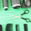 Comb brushes, hairdryer and cutting shears,on color background - ストック写真