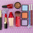 Decorative cosmetics on purple background — Stock Photo