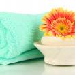 Stock Photo: Rolled towel, soap bar and beautiful flower isolated on white