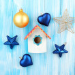 Decorative nesting box and Christmas decorations on blue background — Stock Photo
