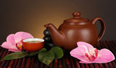 Chinese tea ceremony on bamboo table on brown background — Stock Photo