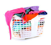 Clothes in plastic basket isolated on white — Stok fotoğraf