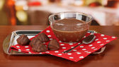 Bowl of chocolate and sweets on table in cafe — Stock Photo