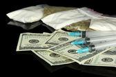 Drugs, money and syringes, isolated on black — Stock Photo