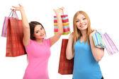 Dos amigas con compras aisladas en blanco — Foto de Stock