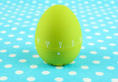 Green egg timer, on color background — Stock Photo