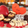 Sweet cookies with hearts and valentine card on table in cafe - Stock Photo