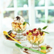 Fruit salad in a sundae dish on window background - Stockfoto