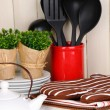 Kitchen settings: utensil, potholders, towels and else  on wooden table — Stok fotoğraf
