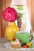 Cup of tea with cake,candy and flower on table in room — Stock Photo