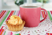 Cup of tea with cake on table in room — Stock Photo