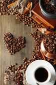 Cup of coffee, pot and grinder on wooden background — Stock Photo