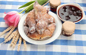 Taste croissants and jam, on tableclot — Stock Photo