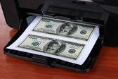Printer printing fake dollar bills on wooden background — Stock Photo
