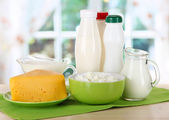 Dairy products on table in kitchen — Stock Photo