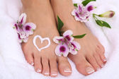 Beautiful woman legs with cream on white towel — Stok fotoğraf