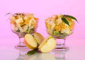 Fruit salad in a sundae dish on a light background — Stock Photo