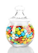Colorful candies in glass jar isolated on white — Stock Photo