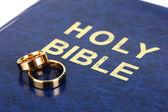 Wedding rings on bible — Stock Photo