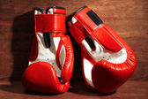 Boxing gloves on wooden background — Stock Photo