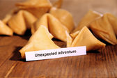 Fortune cookies on wooden table — Stock Photo