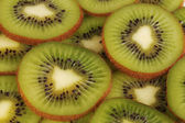 Kiwi slices background — Stock Photo