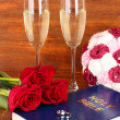 Wedding rings on bible with roses and glasses of champagne on wooden background — 图库照片