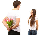Loving couple with tulips isolated on white — Stock Photo