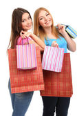 Two girl friends with shopping isolated on white — Stock Photo