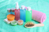 Hotel cosmetics kit on blue towel — Stockfoto