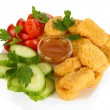 Fried chicken nuggets with vegetables and sauce isolated on white - Stock Photo