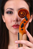 Beautiful young girl with violin close up — Stock Photo
