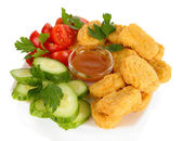 Fried chicken nuggets with vegetables and sauce isolated on white — Stock Photo