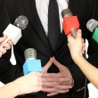 Conference meeting microphones and businessman — Stock Photo #22482409