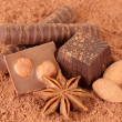 Chocolate sweets with cocoa, on brown background - Stock Photo