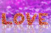 Word Love on purple background — Stock Photo