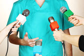 Conference meeting microphones and doctor — Stock Photo