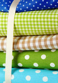 Color mottled fabrics close-up background — Stock Photo