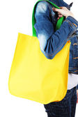 Yellow bag with green handles on shoulder isolated on whit — Stock Photo