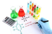 Hand scientist writing formulas isolated on white — Стоковое фото