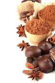 Composition of chocolate sweets, cocoa and spices, isolated on white — Stock Photo