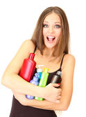 Woman with long hair holding bottles of shampoo, isolated on white — Stock Photo