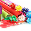 Stock Photo: Rolls of Christmas wrapping paper with ribbons, bows isolated on white