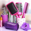 Постер, плакат: Hair brushes hairdryer and cosmetic bottles in beauty salo