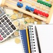 Bright wooden abacus and calculator. Conceptual photo of old and modern business — Stock Photo #22531355