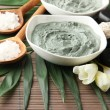 Composition with cosmetic clay for spa treatments, on bamboo background — Stock Photo #22532011