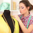 Beautiful young dressmaker in workroom — Stock Photo #22532581